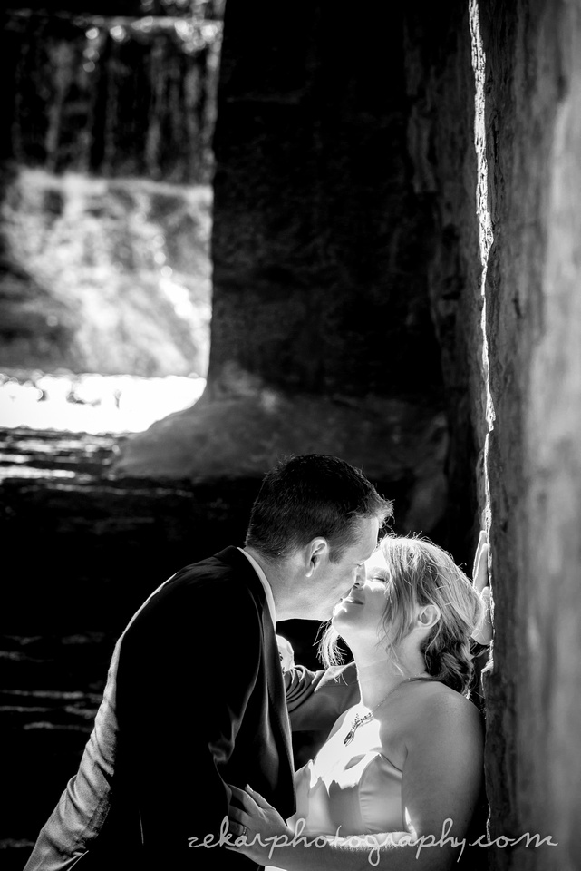 black and white photo of bride and groom kissing