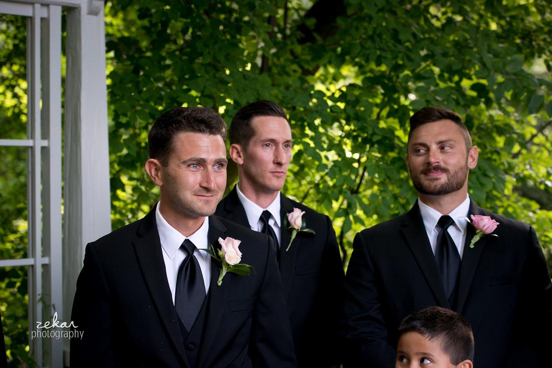 groomsmen watching groom