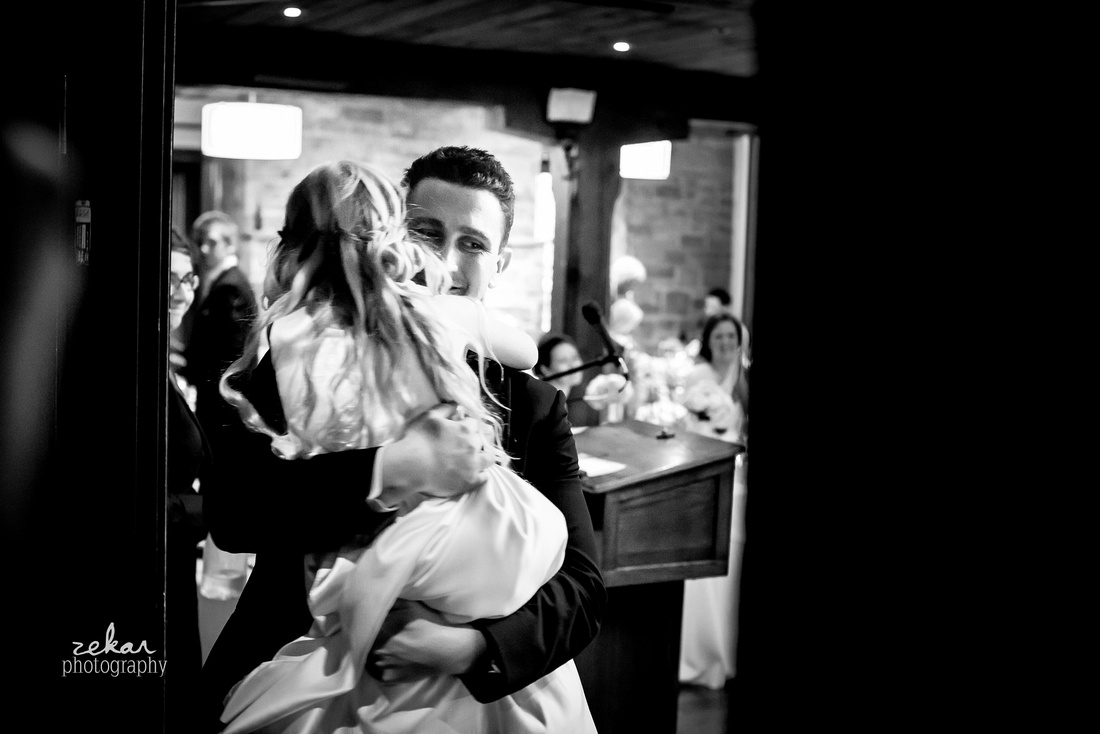 groom and flower girl hugging