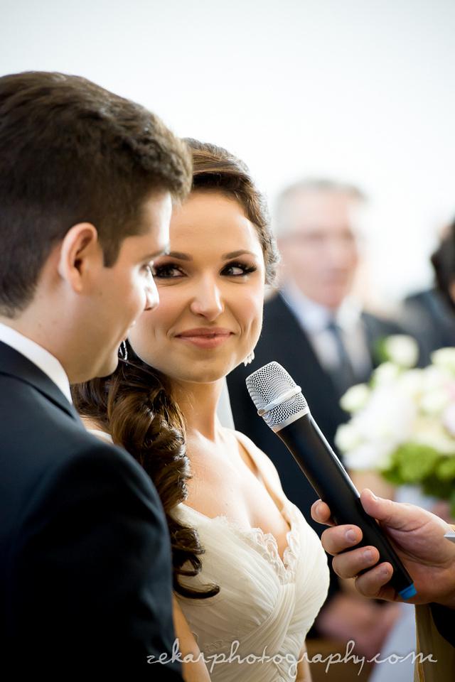 bride looking at groom vows