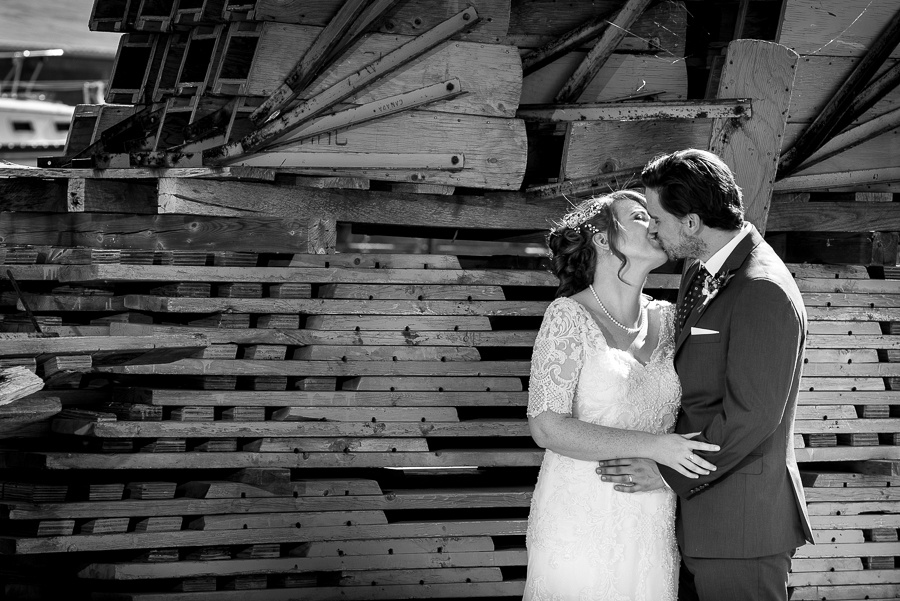 kissing by wood pile