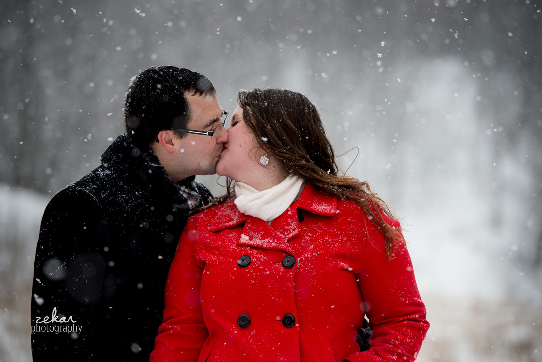 couple kissing in the woods