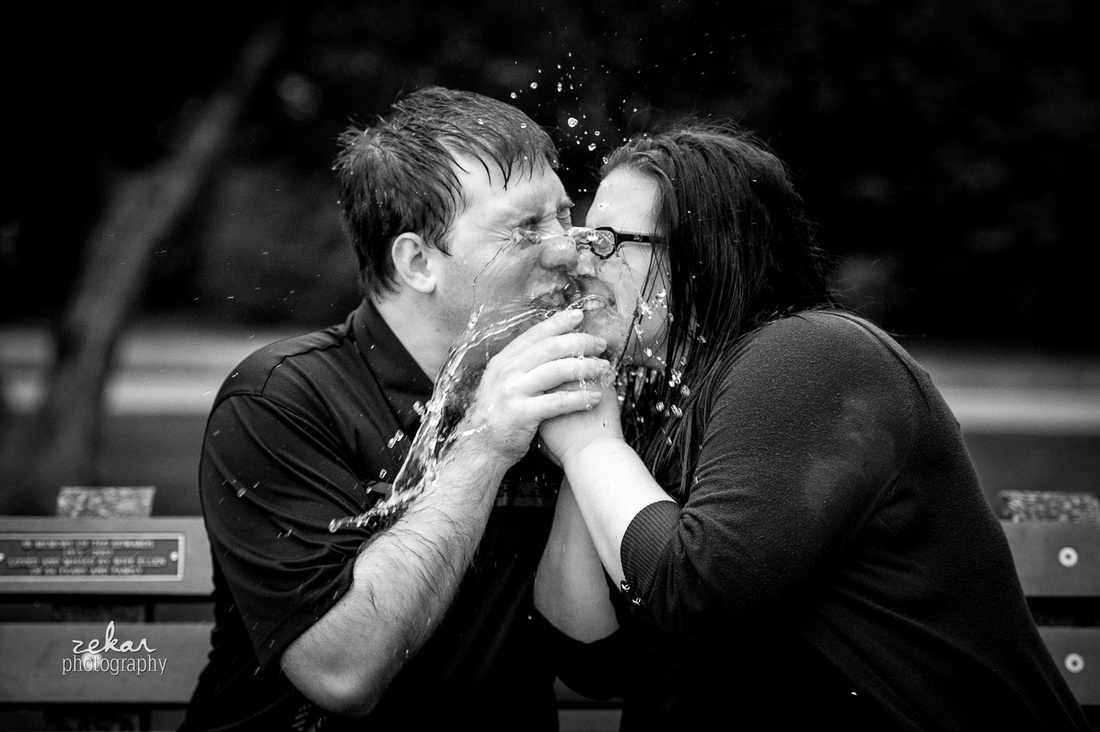 black and white water balloon exploding in face