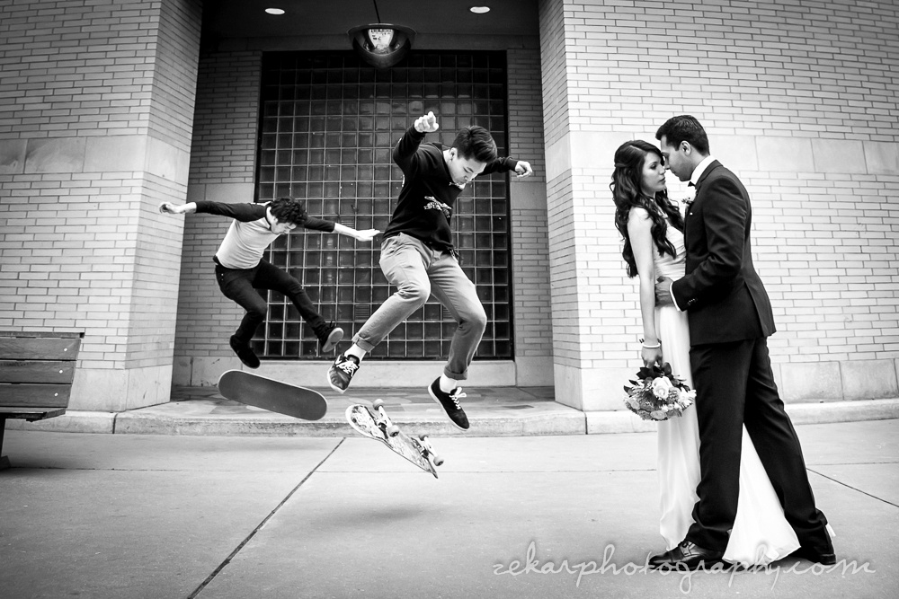 black and white photo skateboarding bride and groom