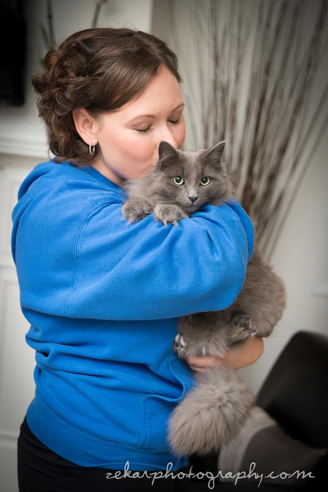 girl cuddling a gray cat