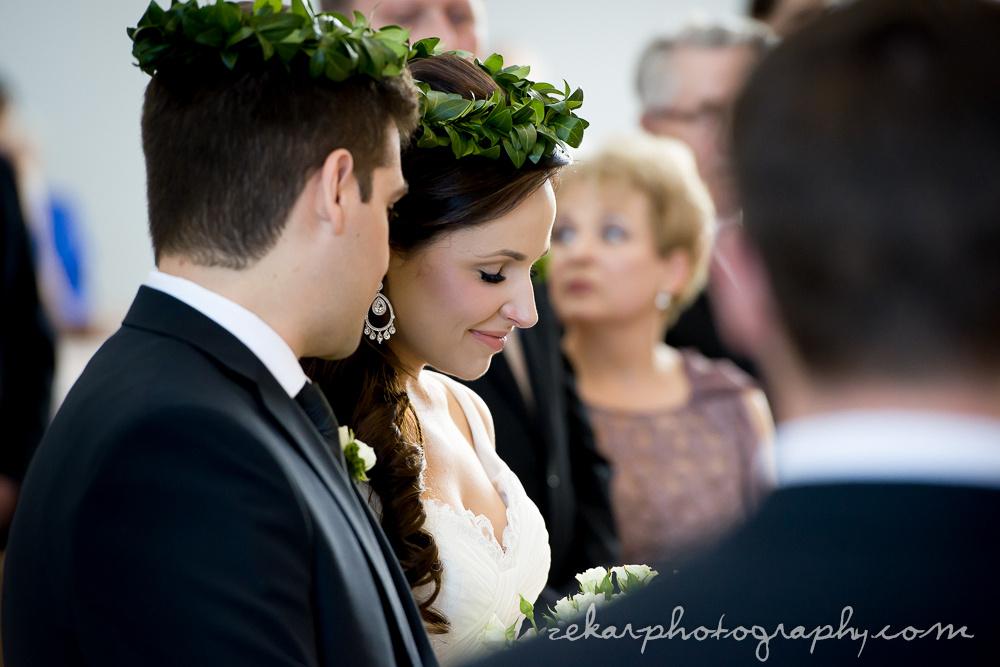 groom telling secret to bride