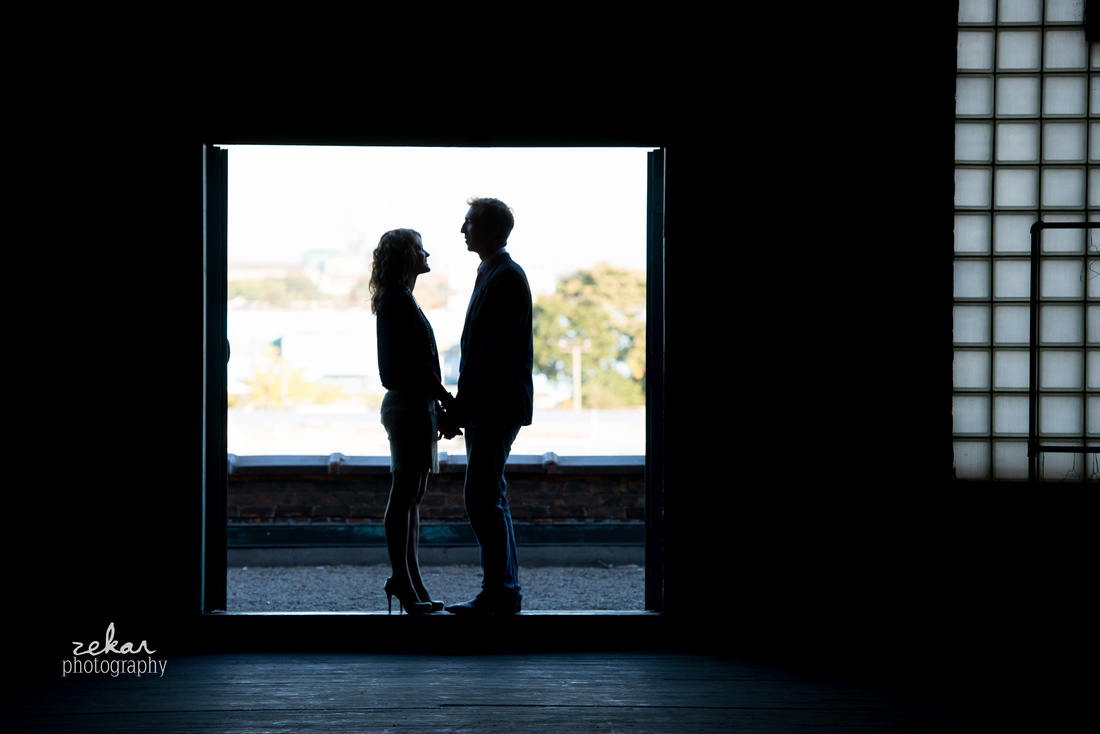 silhouette of man and woman in doorway
