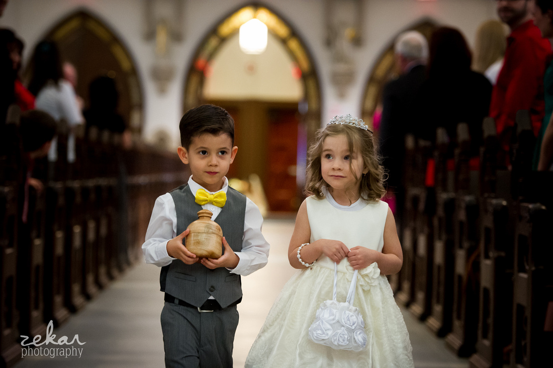ring bearer and flower girl coming down aisle