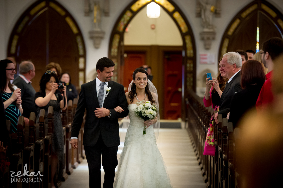 dad walking daughter down aisle