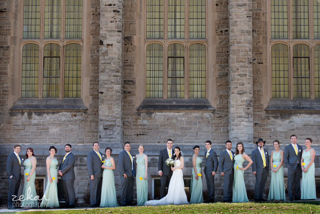 bridal party shot outside of old church