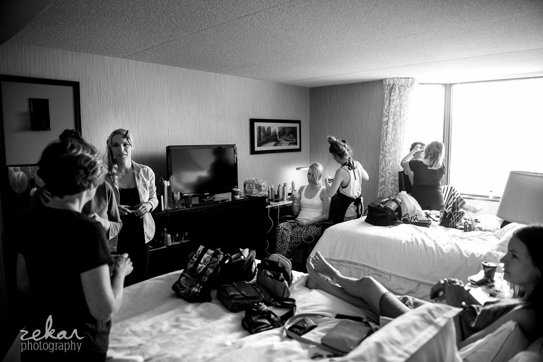 busy room of bridal party getting ready