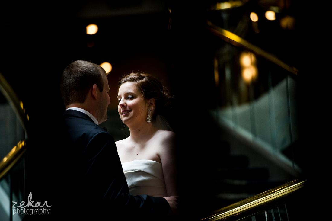 bride smiling at groom in hotel lobby
