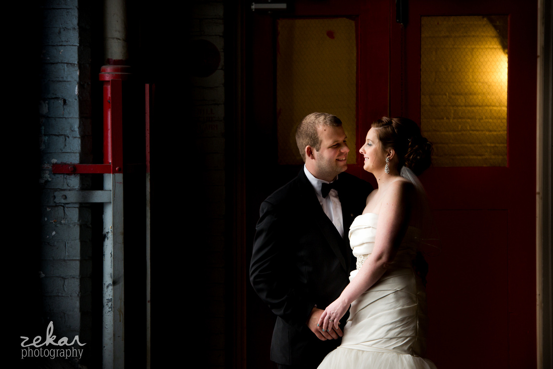 bride and groom snuggling in abandoned building