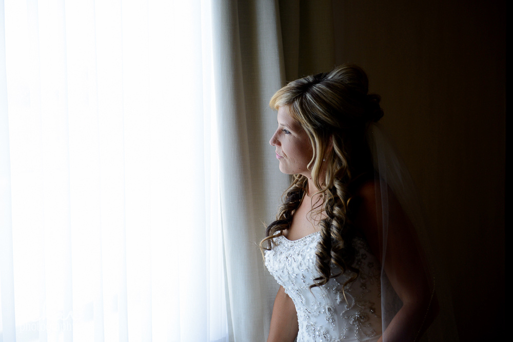 bride looking out hotel window