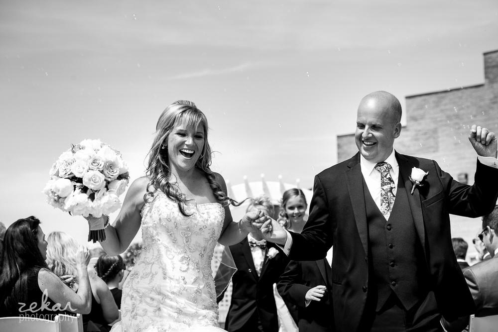 happy couple coming down aisle