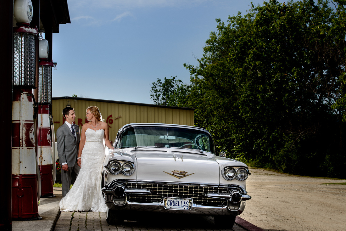 bridal couple next to cool 50's car