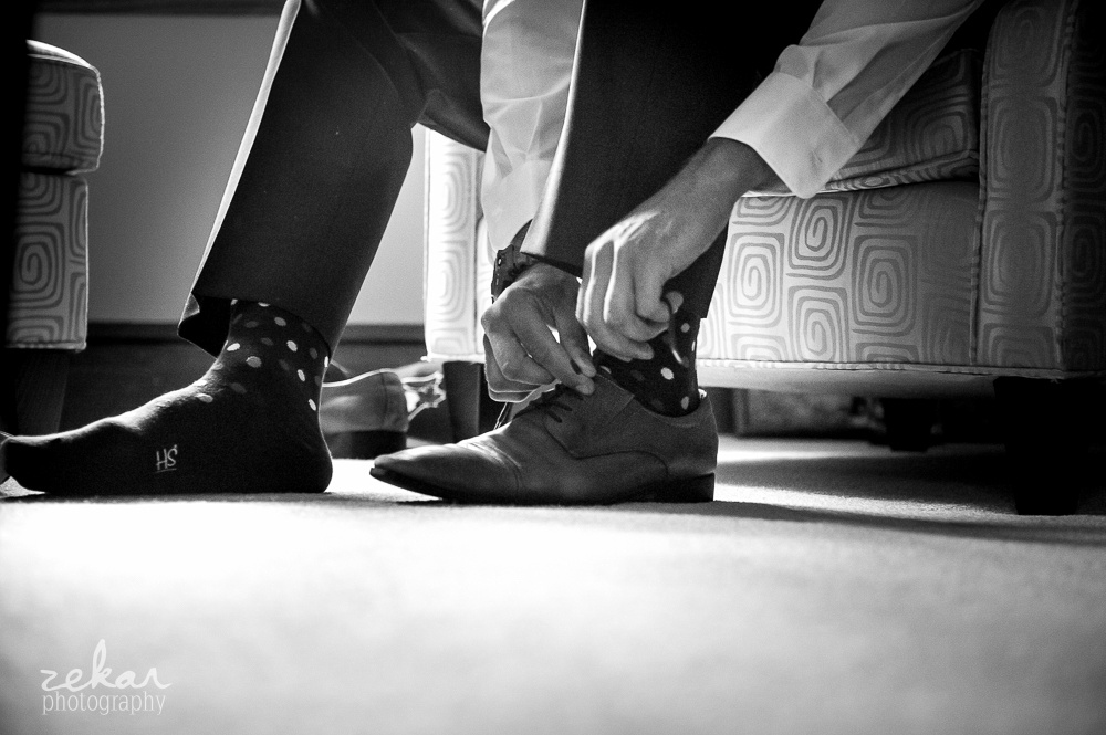 groom putting socks on
