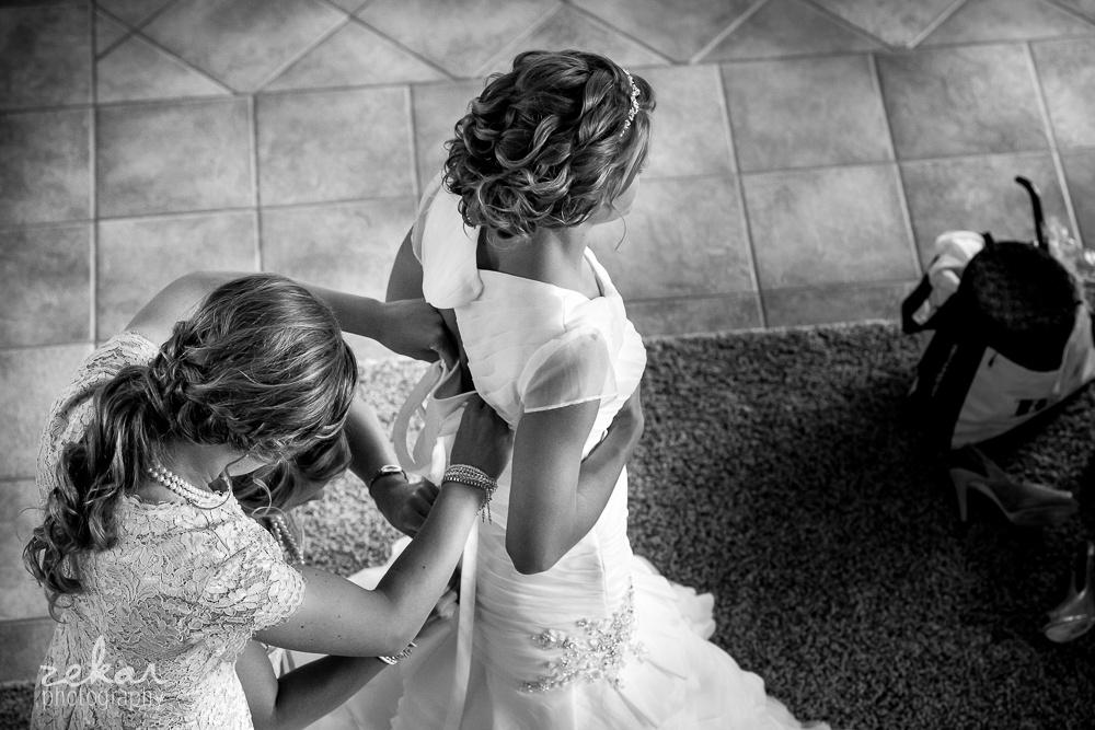 bridesmaids getting bride ready