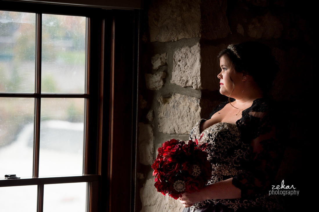 bride standing by window ambient lighting