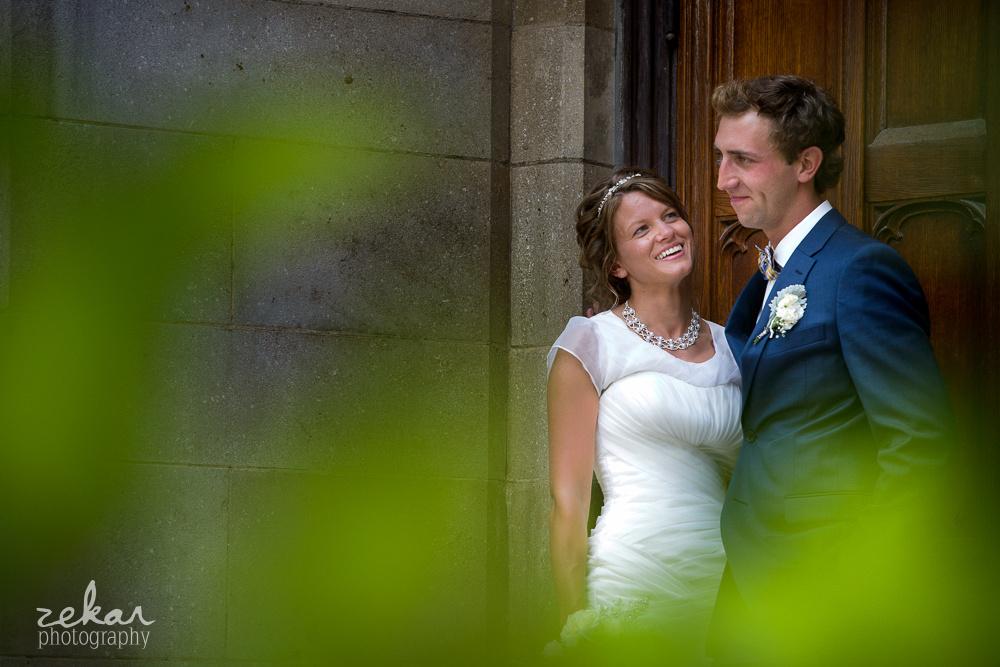 bride looking up at groom