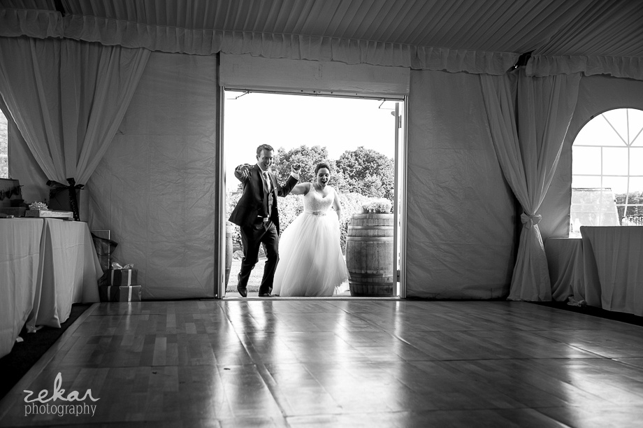 couple walking into reception