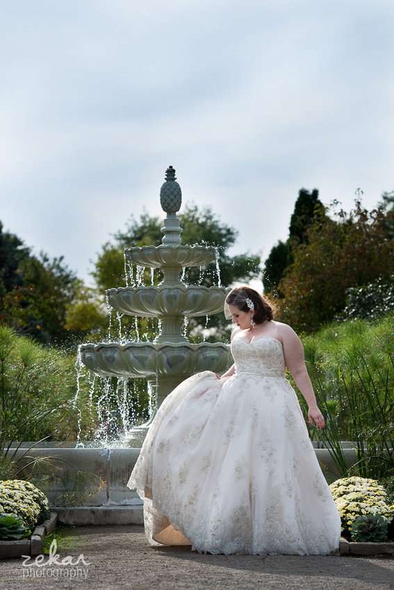 bride by fountain