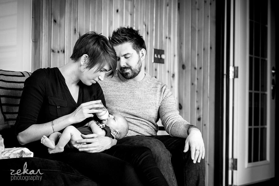 parents feeding baby