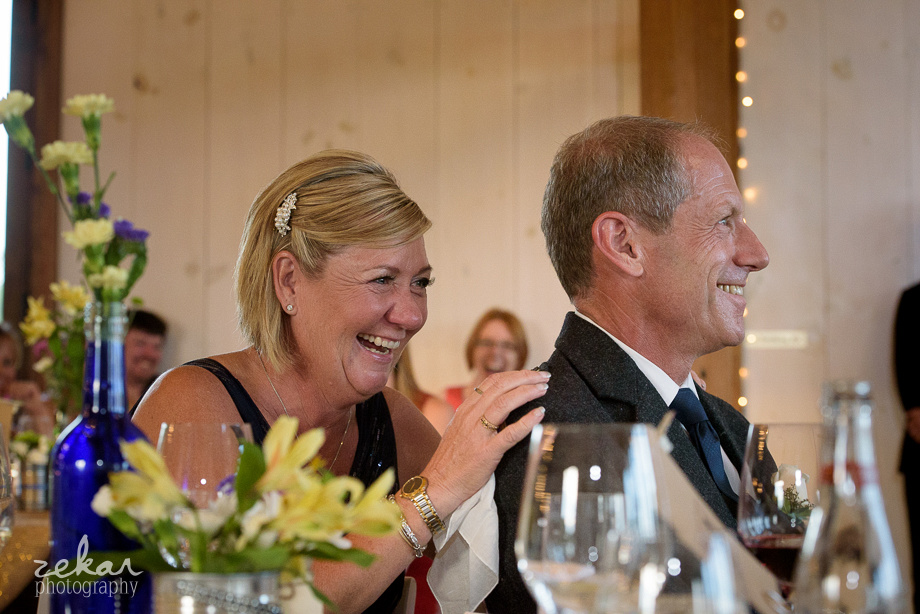 parents laughing at reception