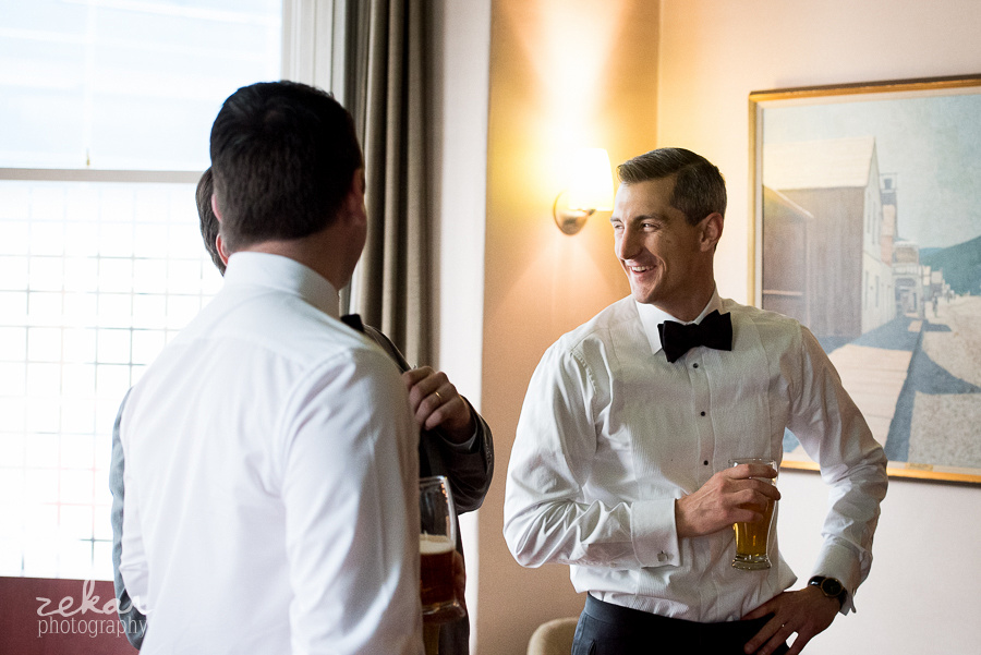 groom laughing with friends
