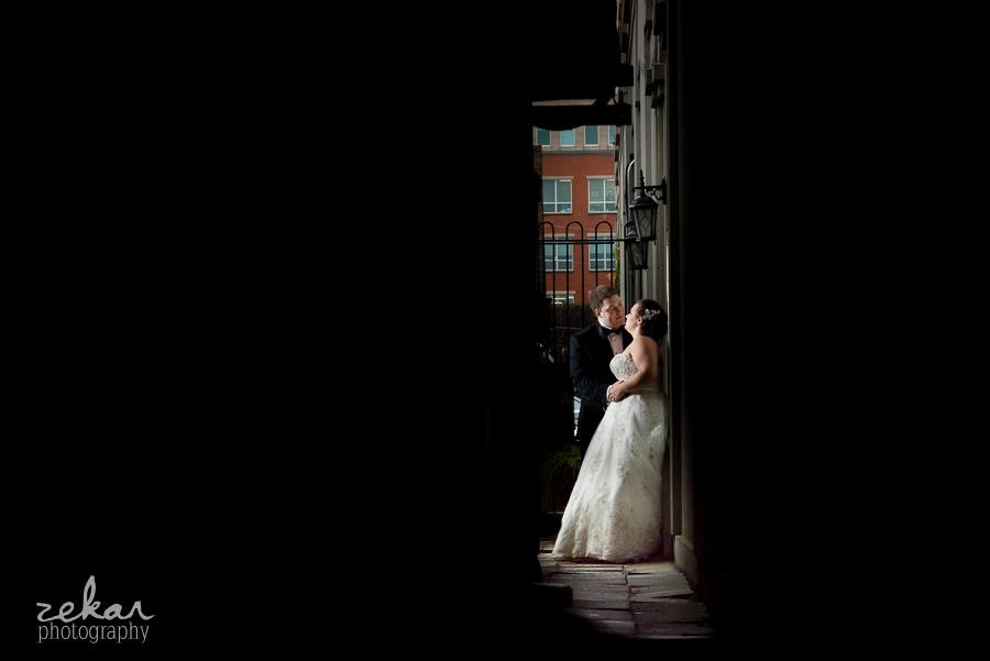 bride and groom in alleyway