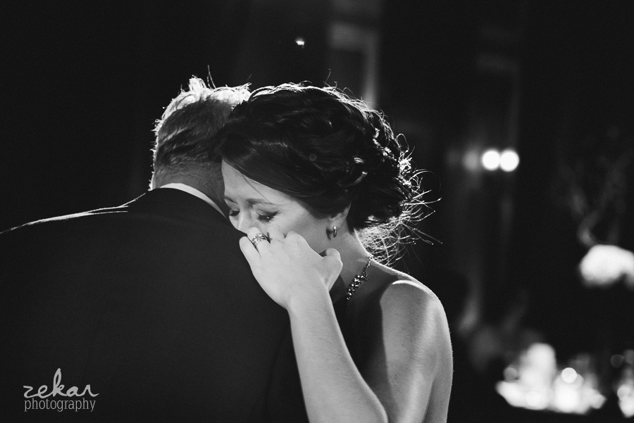 bride dancing with father crying
