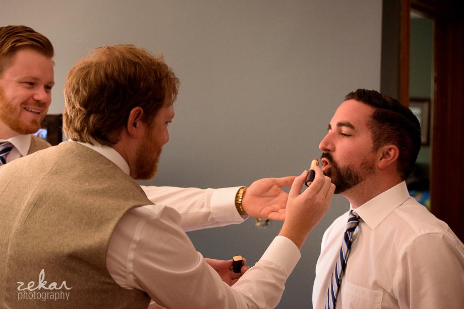 groom getting lipstick on