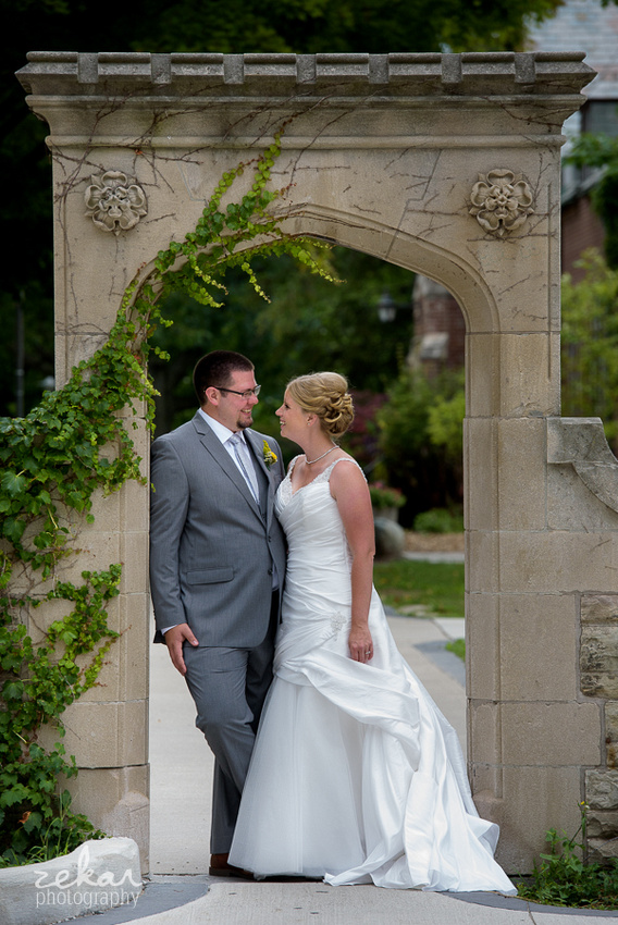 bridal couple under stone archway