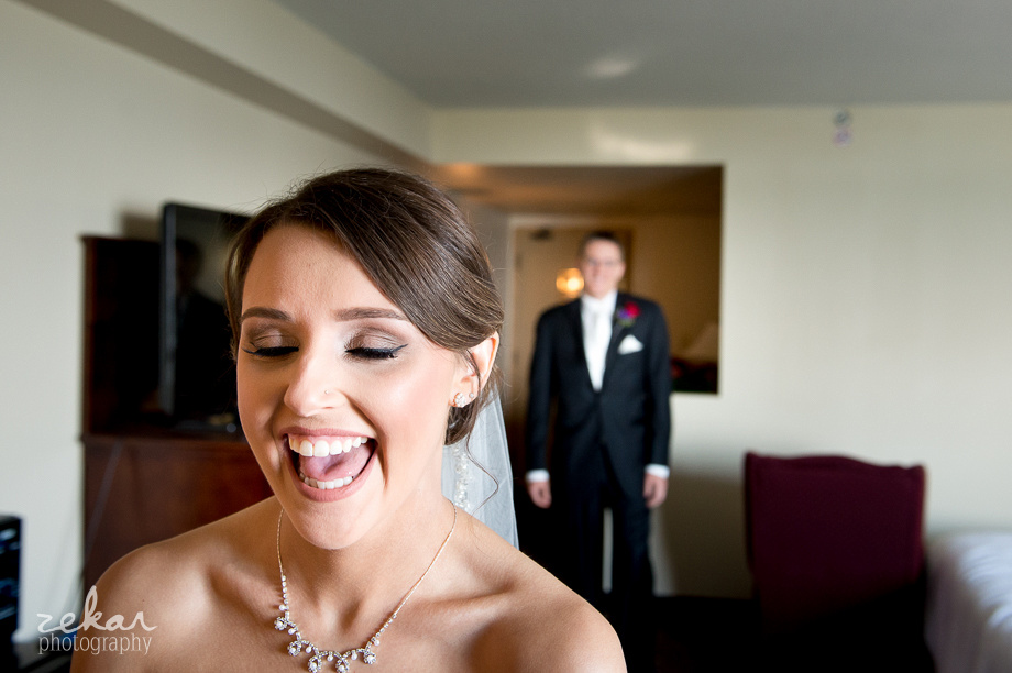 adorable bride waiting for groom to see her