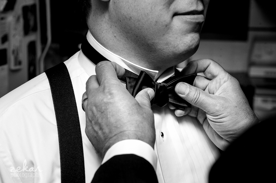 dad putting bow tie on