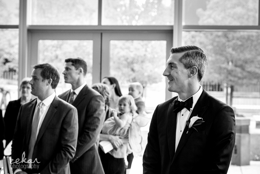 groom watching bride down aisle