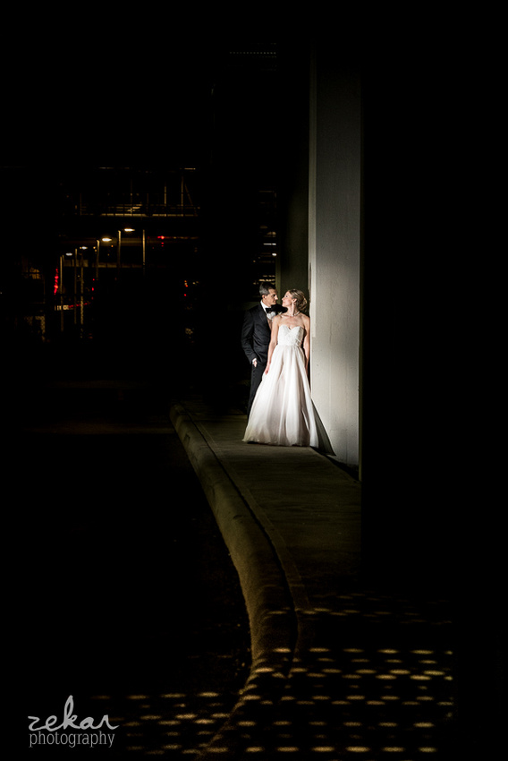 bride and groom portrait under bridge