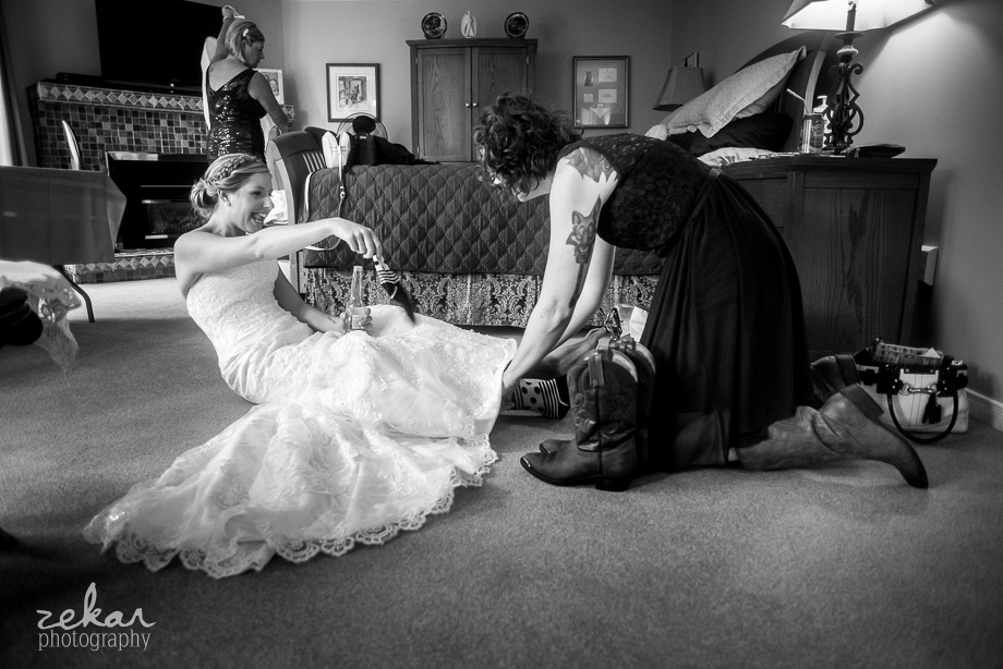 bride getting boots on
