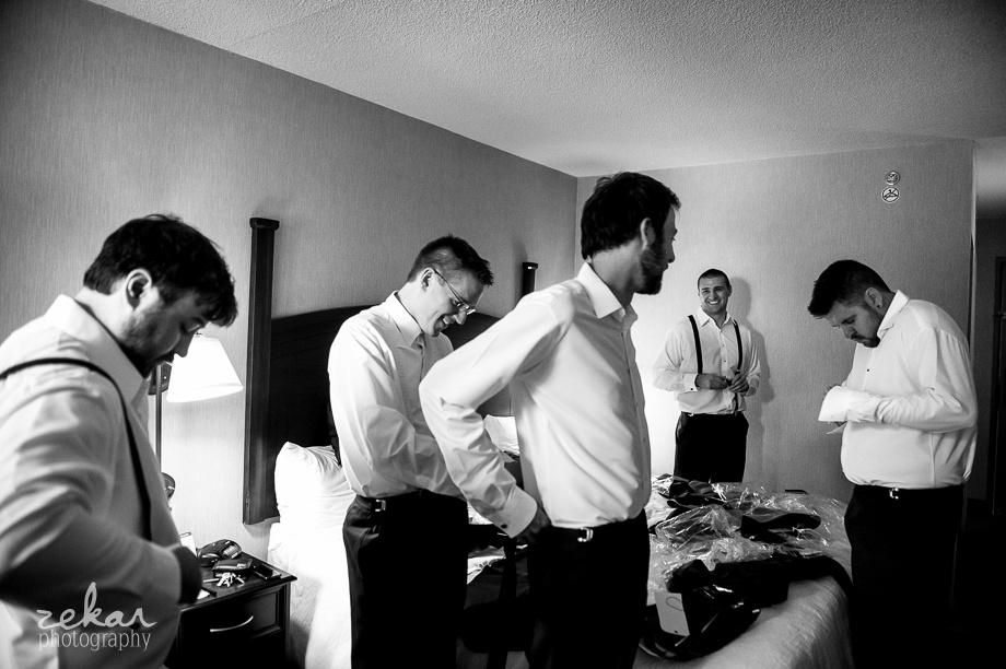 groomsmen putting ties on