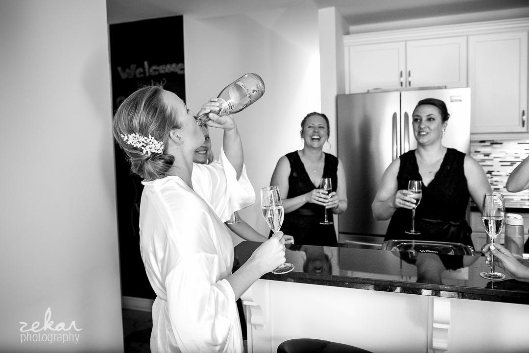 bride chugging champagne