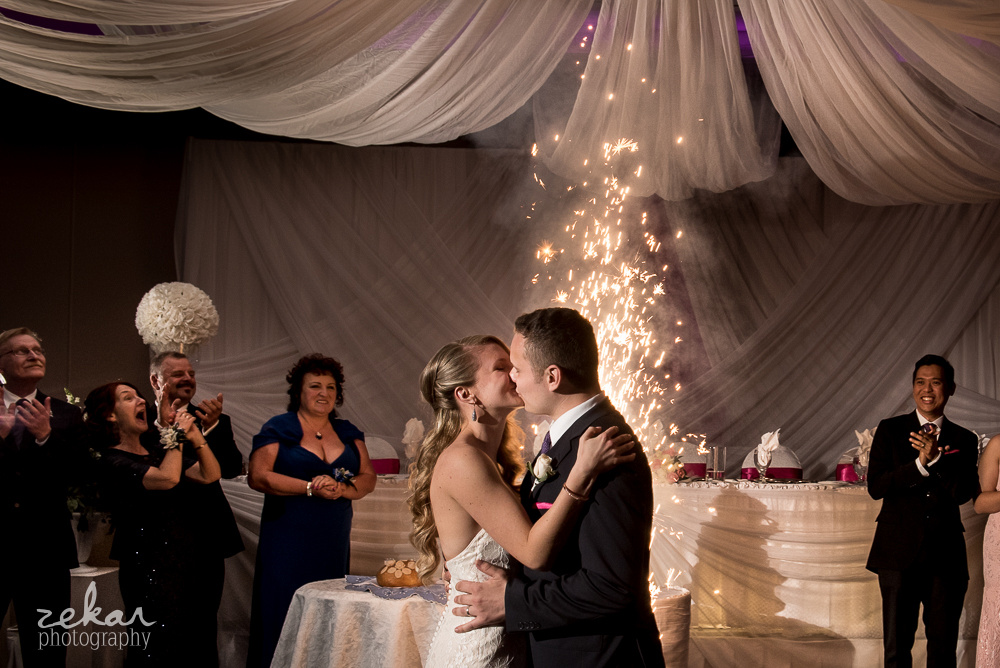 bride and groom kissing sparklers