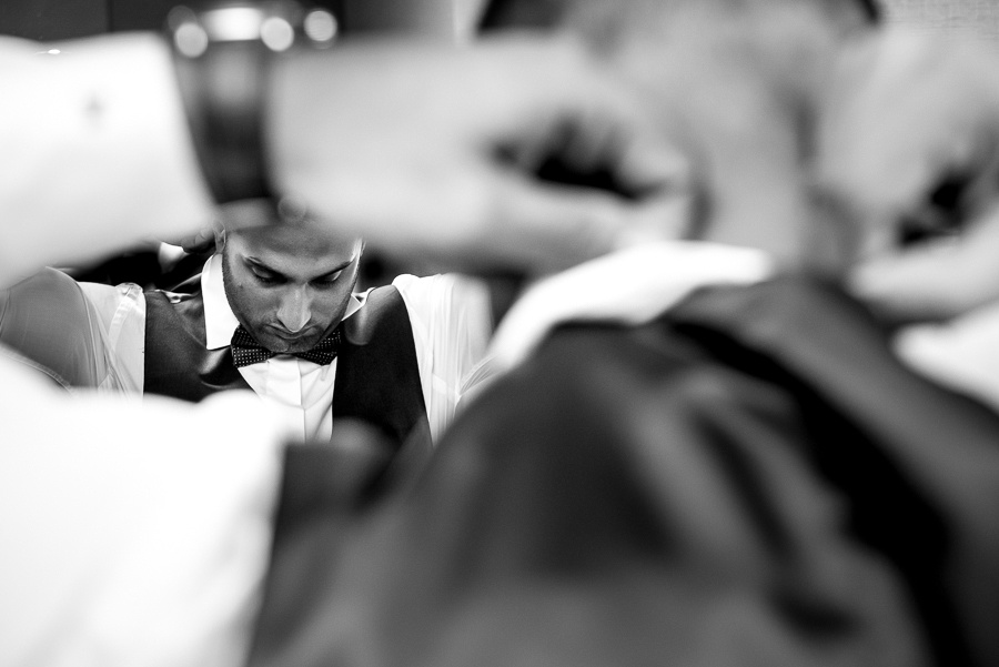 groom putting bowtie on