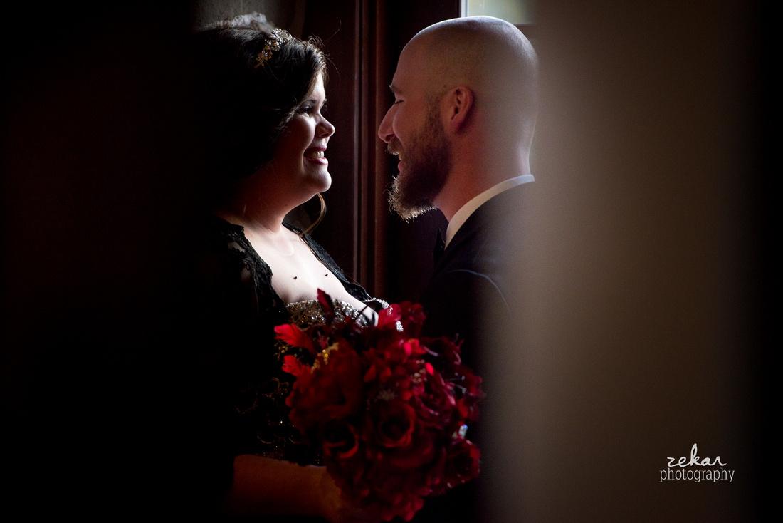 sneak pictures bride and groom in hallway