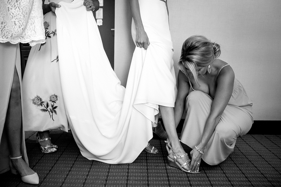 bridemaid getting shoes on