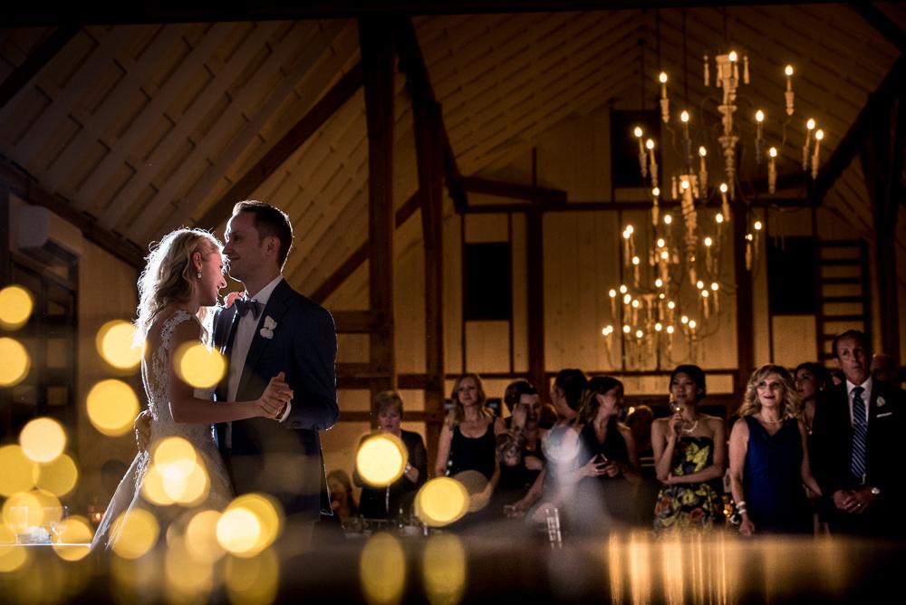 guests watching bride and groom dance