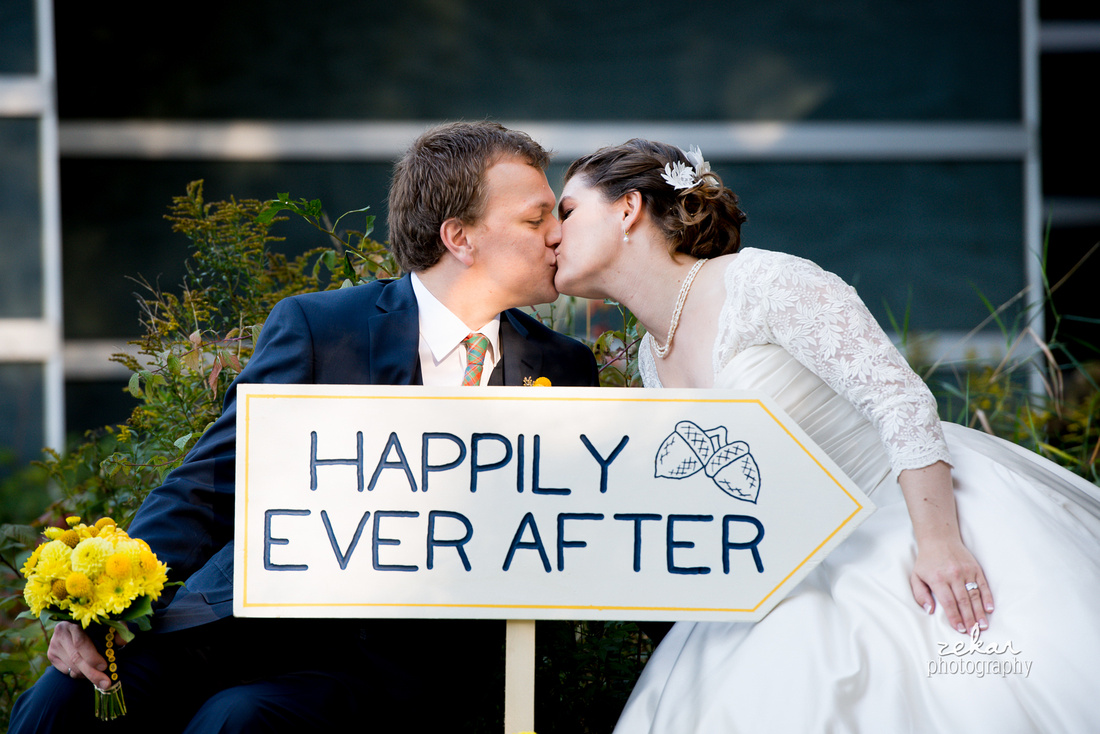 bride and groom happily ever after sign