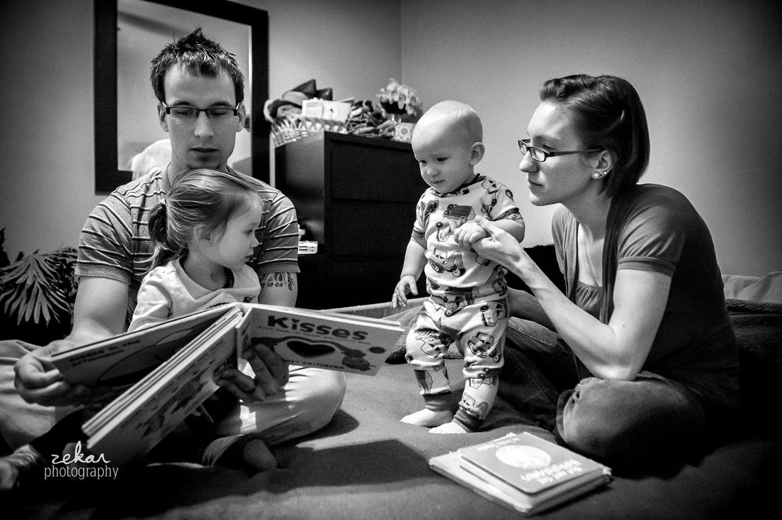 family reading bed time story black and white