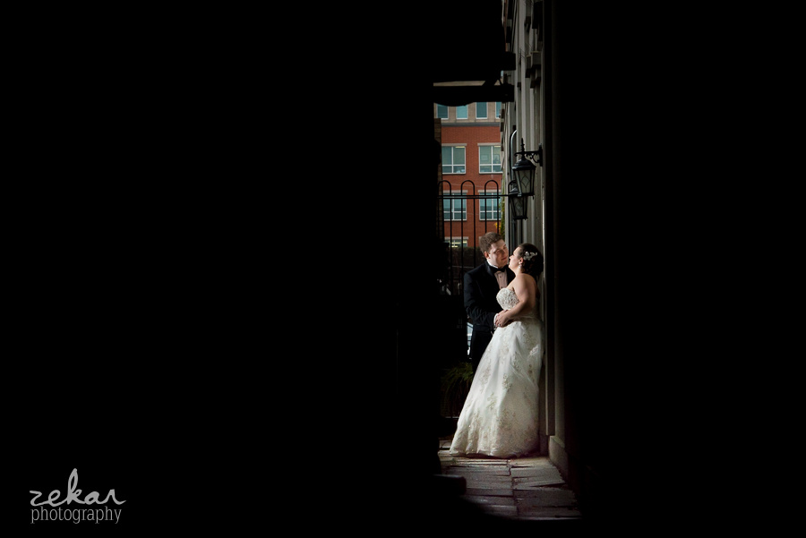 bride and groom in alleyway