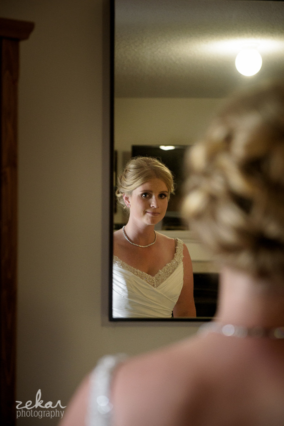 bride looking sweet in mirror