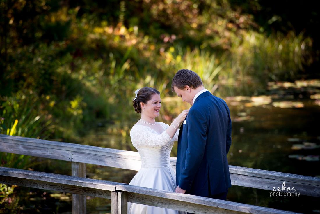 bride fixing groom tux